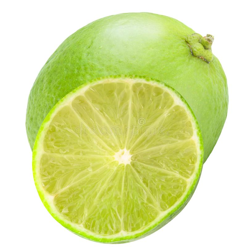 Isolated whole lime and half on white background. Isolated fruits. Isolated whole lime and half on white background with clipping path as package design element stock photos