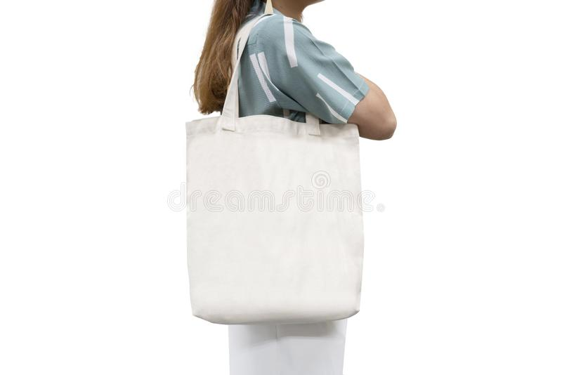 Isolated woman carried white canvas bag. Isolated woman carried white canvas tote bag with black copyspace royalty free stock photo