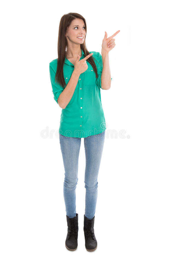 Isolated woman is pointing with finger.