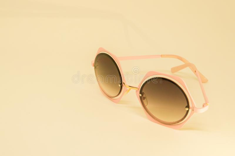 Women cute sunglasses in sepia color royalty free stock image