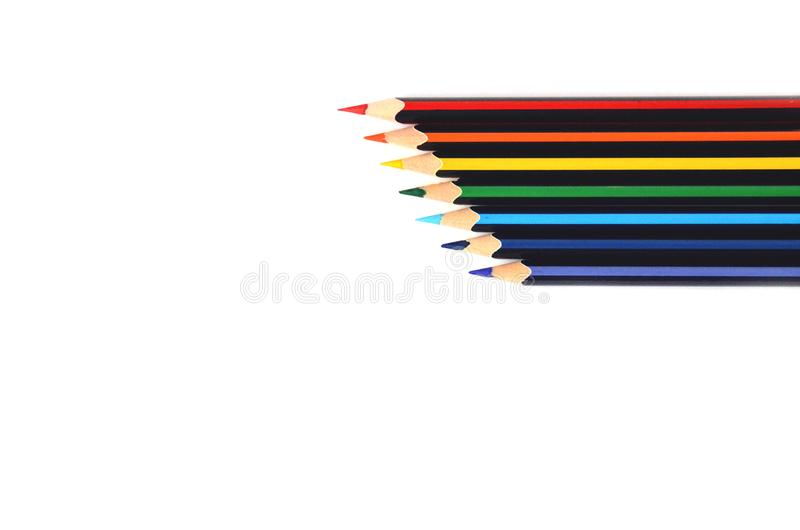 Isolated wooden color pencils on a white background. Pencils like a rainbow in the corner horizontally. royalty free stock photo