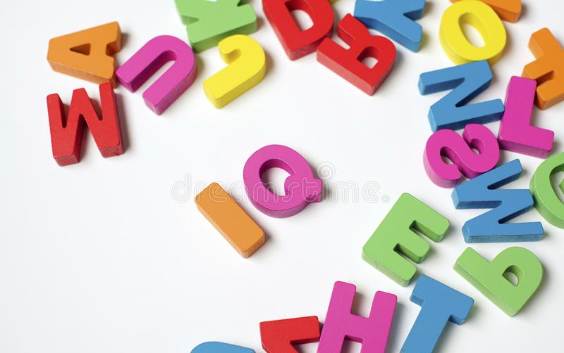 Isolated Wooden Letter IQ or ` intelligence quotient ` royalty free stock images