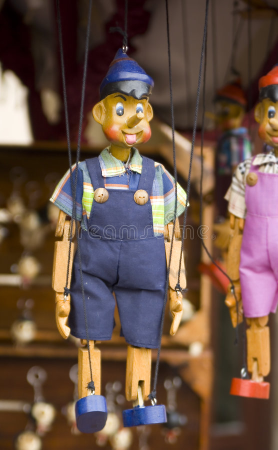 Isolated wooden puppet. Wooden toy puppet marionette string controled pinocchio stock image