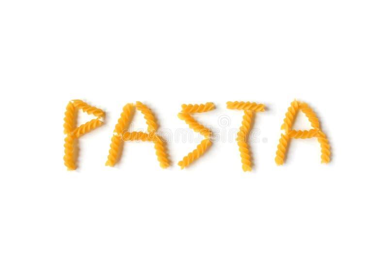 Isolated word pasta made of yellow durum pasta on a white background. Fusilli swirl pasta. stock photos