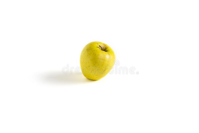 Isolated yellow apple on white background royalty free stock image