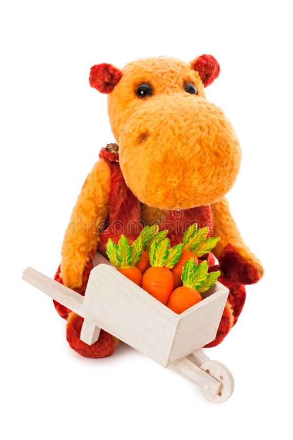 Isolated Yellow Hippo Toy With The Cart Full Of Carrot Stock Photo
