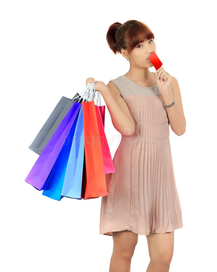 Young Asian Woman With colorful Shopping Bags. Isolated Young Asian Woman With colorful Shopping Bags stock photography
