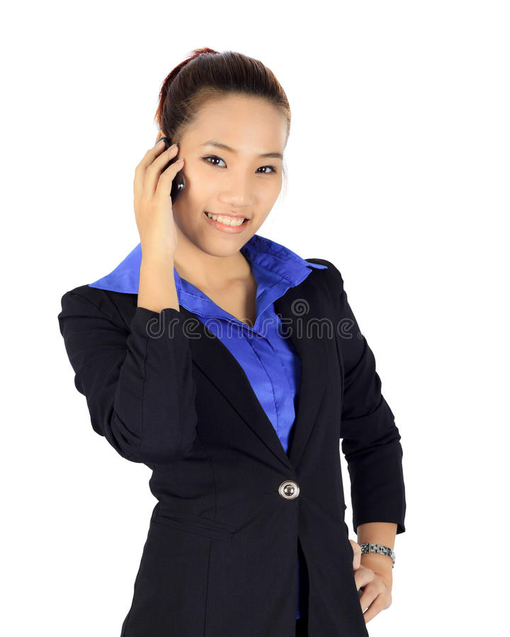 Isolated young business woman has a conversation on a mobile phone royalty free stock photos