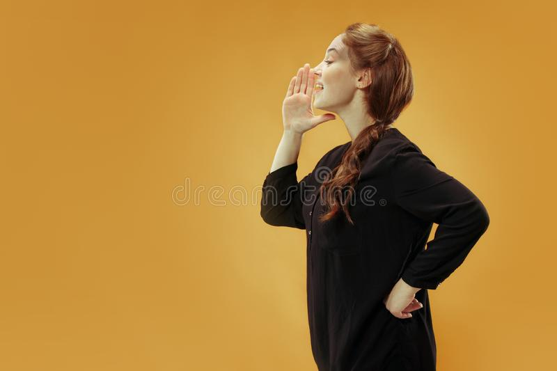 Isolated on young casual woman shouting at studio royalty free stock images