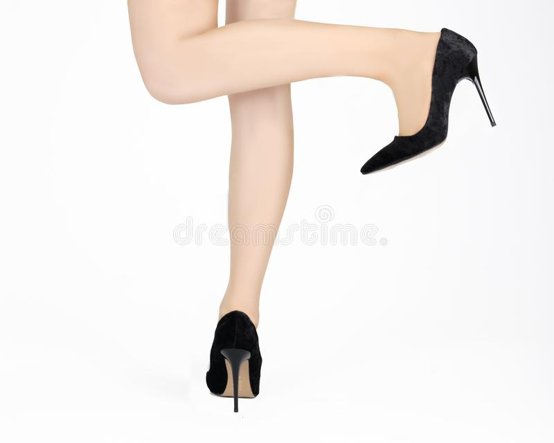 Isolated young female legs, skirt and stiletto.  stock photography