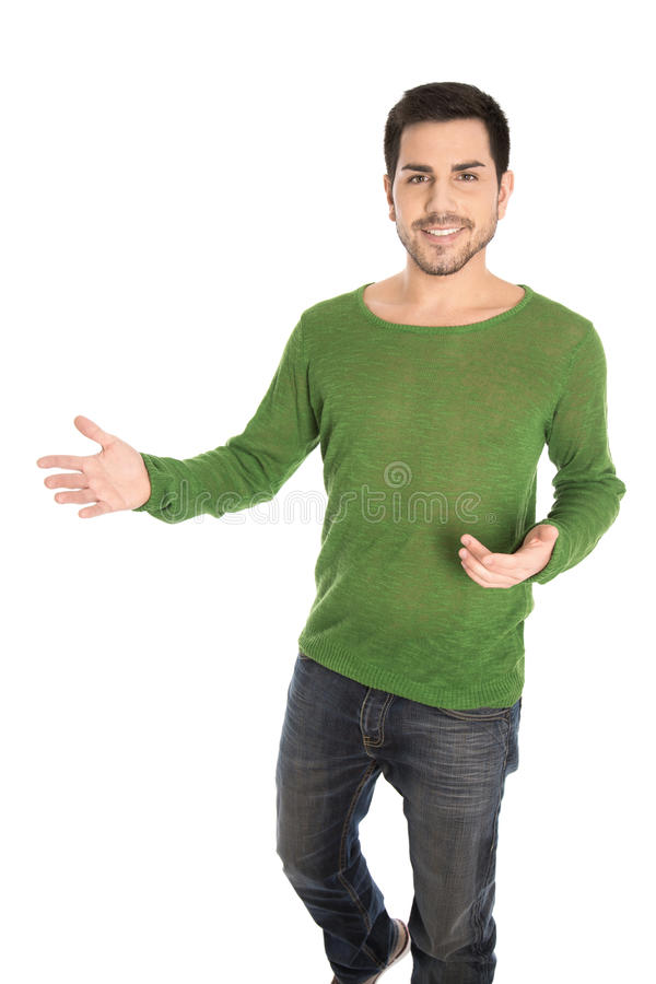 Isolated young smiling casual man making hand gesture for sales royalty free stock images