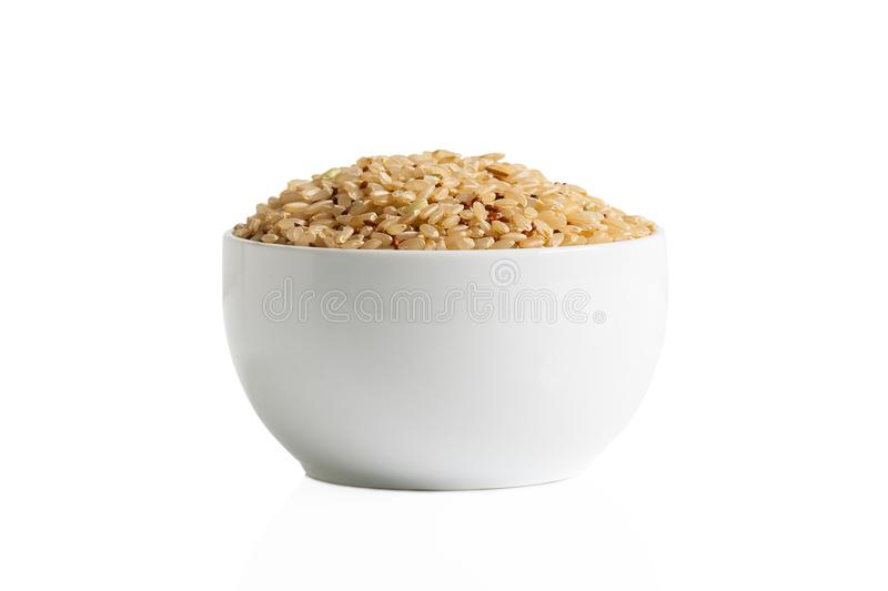 Brown rice and quinoa in a cup royalty free stock photos