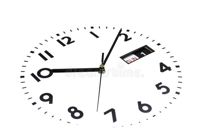 Isolato Il fronte dell'orologio è inclinato Il quadrante degli orologi Le mani sull'orologio Calendario, domenica, primo giorno I fotografia stock libera da diritti