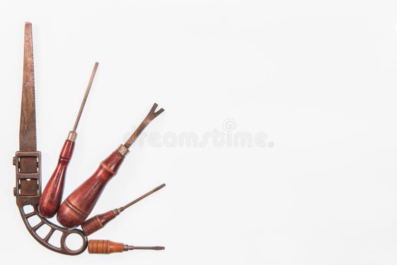 Isolato su un set di strumenti di legno dell'oggetto d'antiquariato della maniglia del fondo bianco fotografia stock
