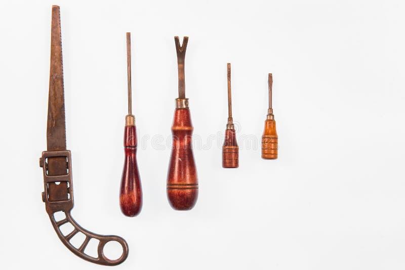 Isolato su un si di legno del set di strumenti dell'oggetto d'antiquariato della maniglia del fondo bianco immagine stock