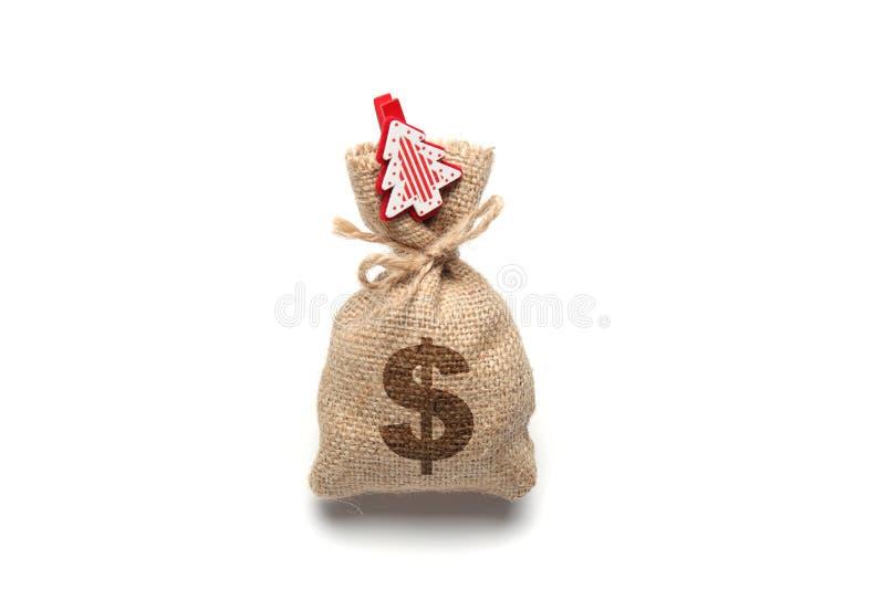 Isolato sulla borsa bianca con soldi, albero di Natale del simbolo di dollaro e del nuovo anno e immagini stock libere da diritti