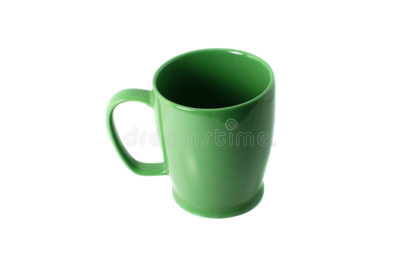 Isolato verde della tazza su fondo bianco immagine stock libera da diritti
