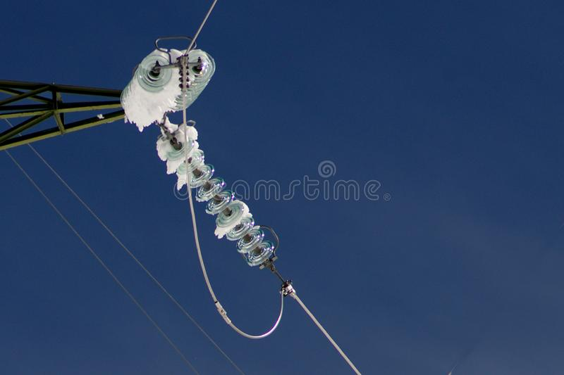 Ice on Isolators of High Tension Powerline stock photography