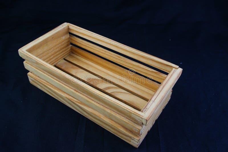 Isole a caixa de madeira com o punho do aperto no fundo preto fotos de stock royalty free