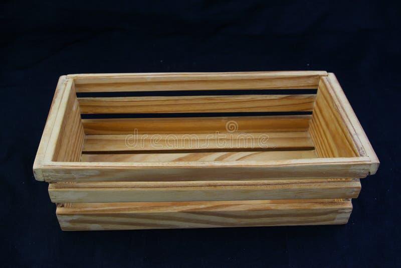 Isole a caixa de madeira com o punho do aperto no fundo preto imagem de stock royalty free