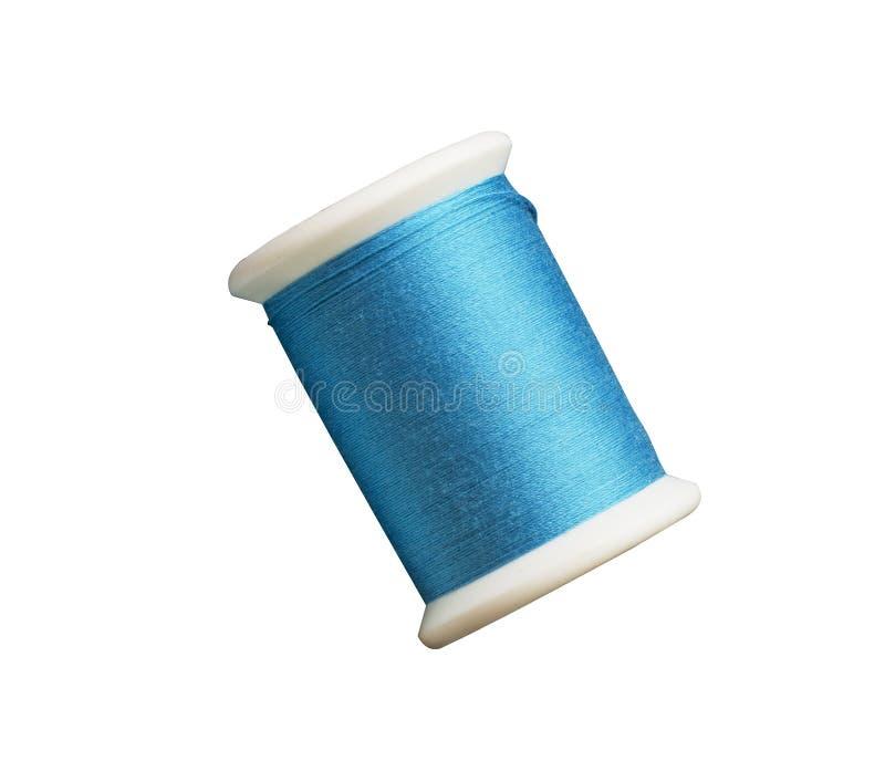 Isoleer blauwe toon naaiende draden royalty-vrije stock afbeeldingen
