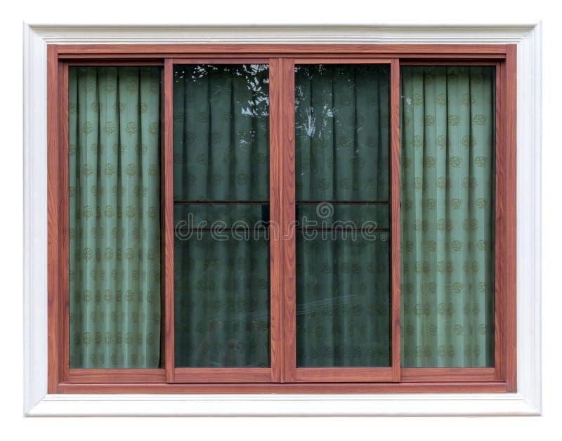 Isolera träfönstret i konkret ram med gardinen arkivbild