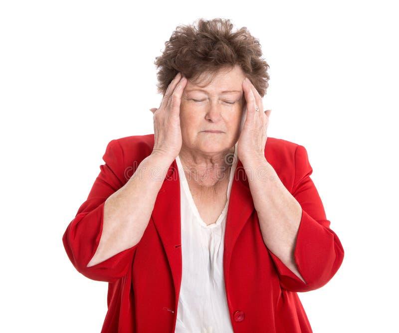 Isolerad äldre kvinna med huvudvärk, migrän eller glömska royaltyfria bilder