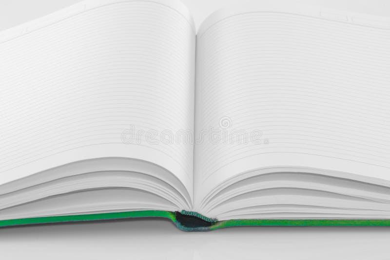 isolerad anmärkningswhite för bakgrund blank bok arkivbild