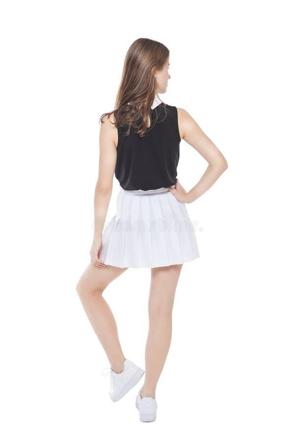 Isolerad barnmodeflicka i vitt posera för kjol _ arkivfoto