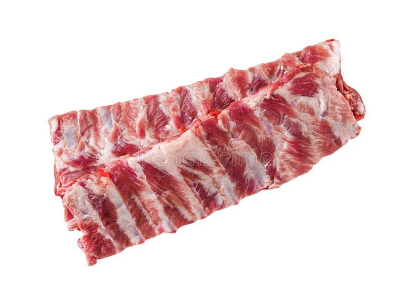 Isolerad bild av rå grisköttstöd på vit bakgrund, bästa sikt royaltyfri fotografi