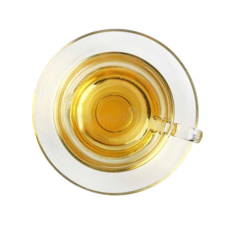 Isolerad genomskinlig glass kopp av grönt te fotografering för bildbyråer