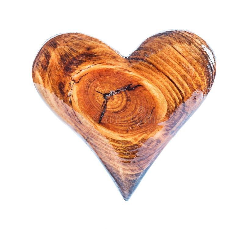 Isolerad glansig laked trähjärta för enkel tappning arkivbilder