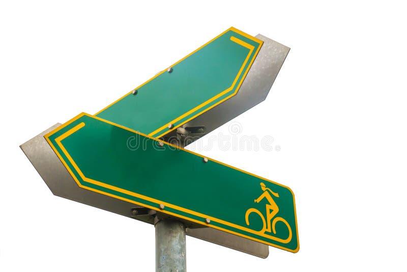 Isolerad grön vägvisare av riktningar för en cykelgränd arkivbilder