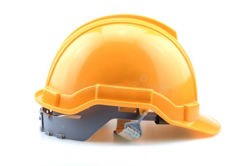 Isolerad gul hjälm för byggmästare arkivfoto