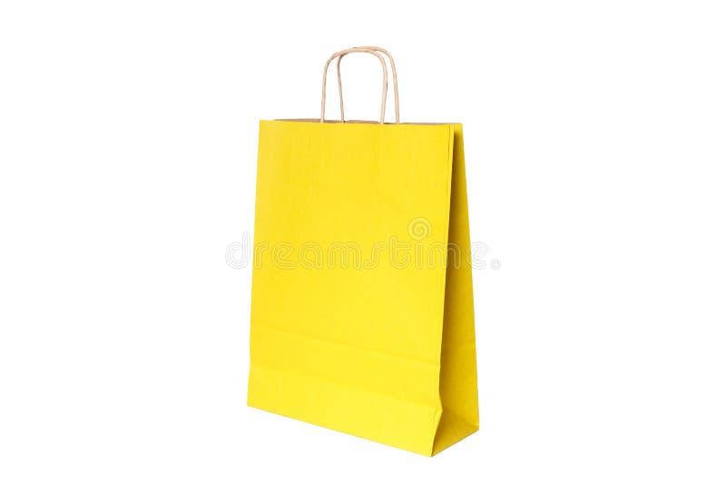 Isolerad gul pappers- shoppa p?se Top besk?dar royaltyfri fotografi