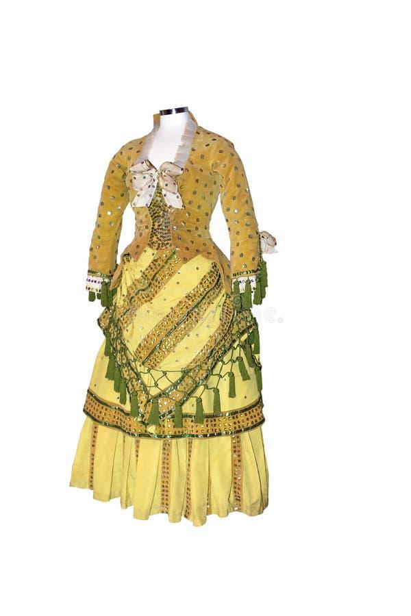 Isolerad gul viktoriansk klänning royaltyfri bild