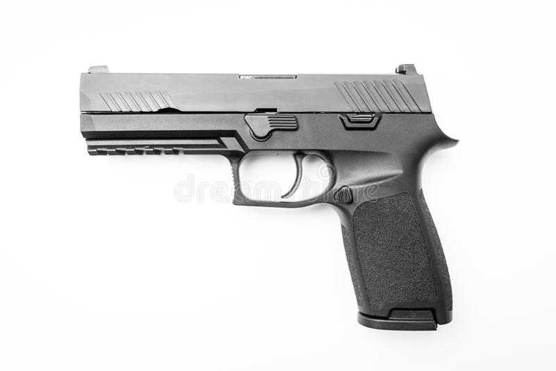 Isolerad handeldvapen på vit bakgrund arkivbild
