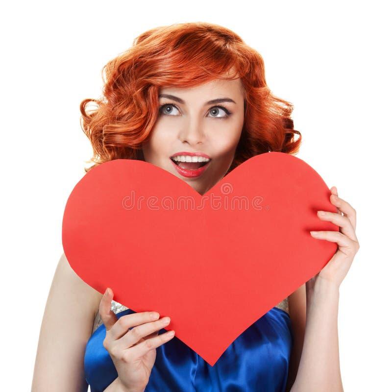 Isolerad hjärta för dag för kvinnaholdingvalentiner arkivfoto
