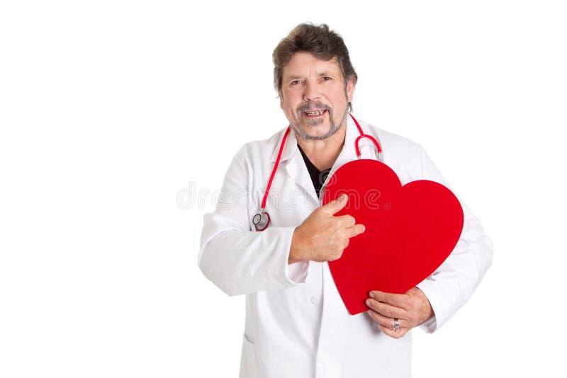 Isolerad kardiolog med tecknet av hjärta royaltyfria foton