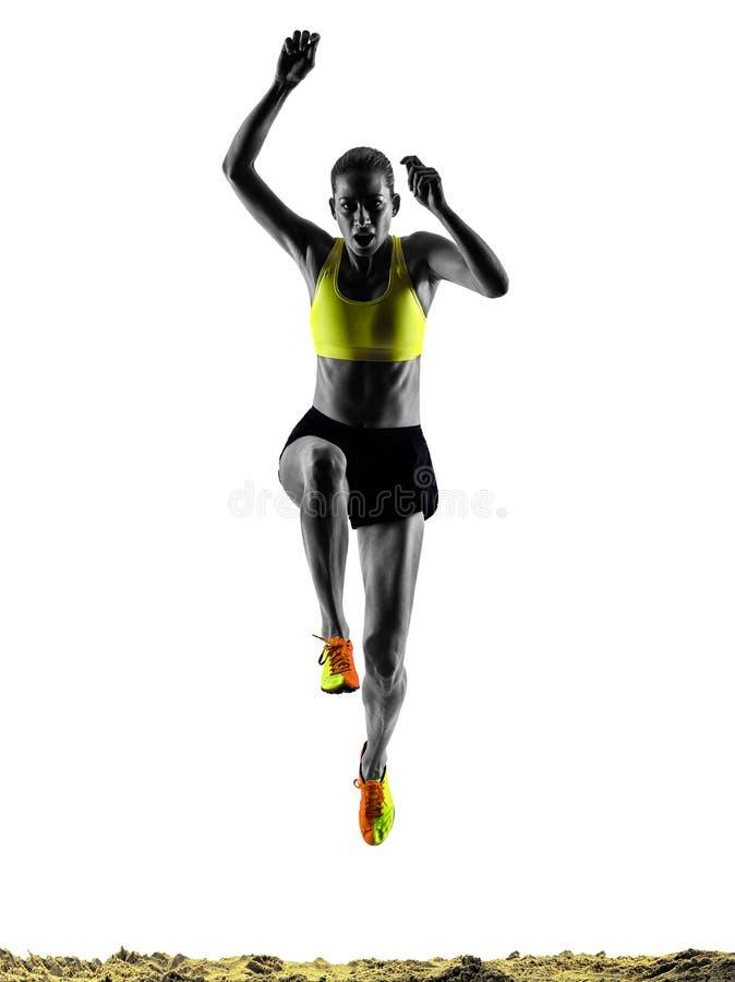 Isolerad kontur för kvinna längdhopp arkivbild