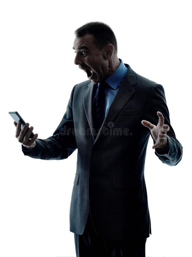 Isolerad kontur för telefon för affärsman royaltyfria foton
