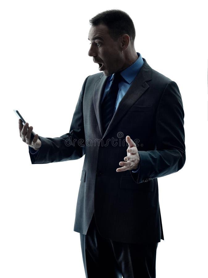 Isolerad kontur för telefon för affärsman royaltyfria bilder