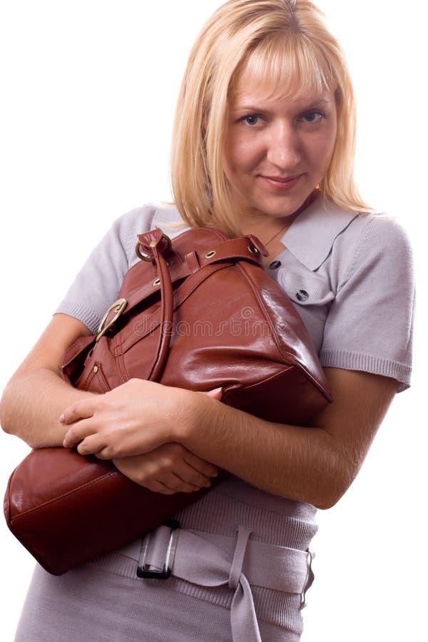 isolerad kvinna för blondin 3 handväska royaltyfri bild