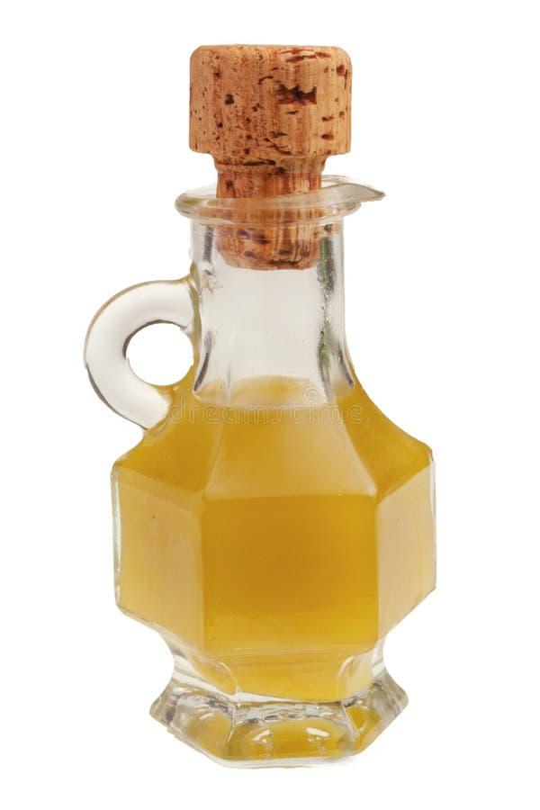 Isolerad liten flaska av olja royaltyfri foto