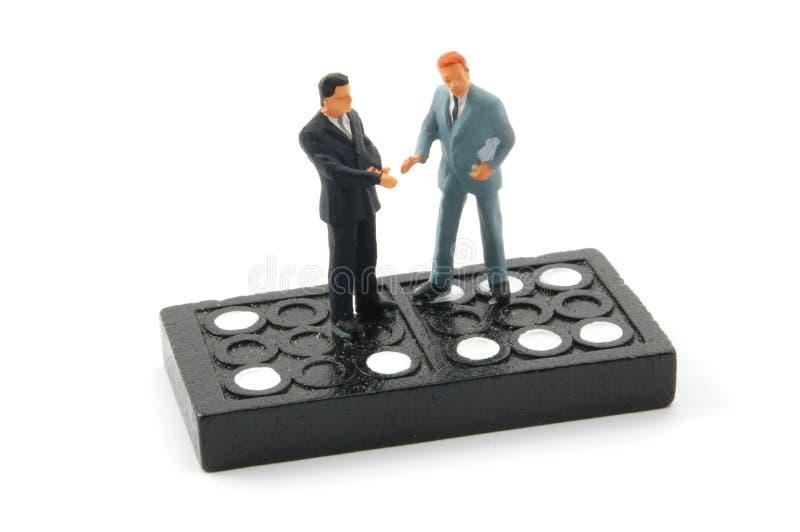 isolerad man för affär domino royaltyfri bild
