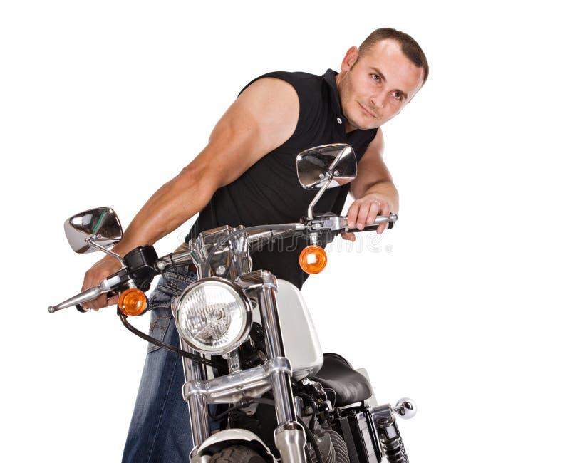 isolerad manmotorbike royaltyfria bilder