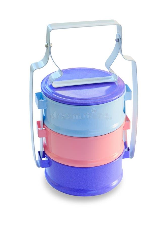 Isolerad matbärare, färgrika tiffinaskar med rostfritt stålramen på vit bakgrund royaltyfri foto
