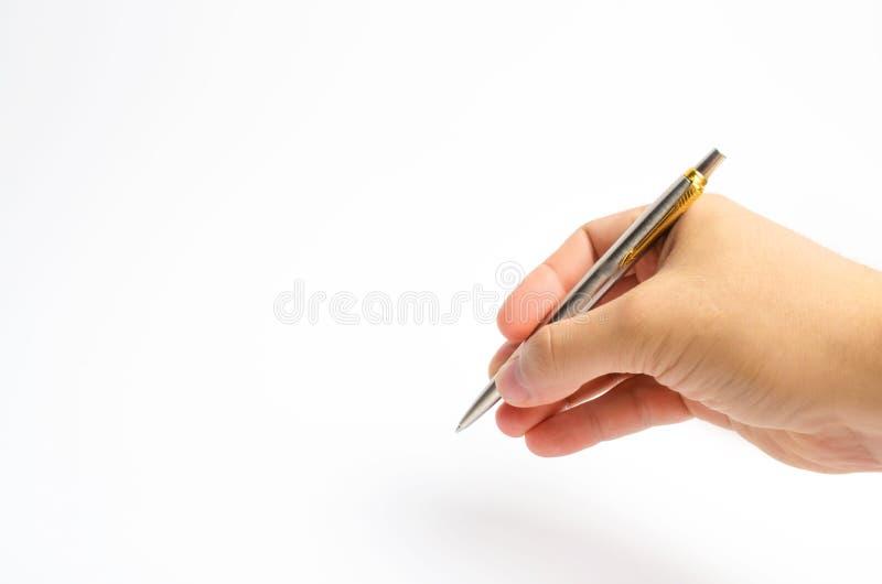 Isolerad penna på vit bakgrund placera text kopiera avstånd handen för man` s skriver fyllnads- ut dokument som håller en dagbok  arkivbild
