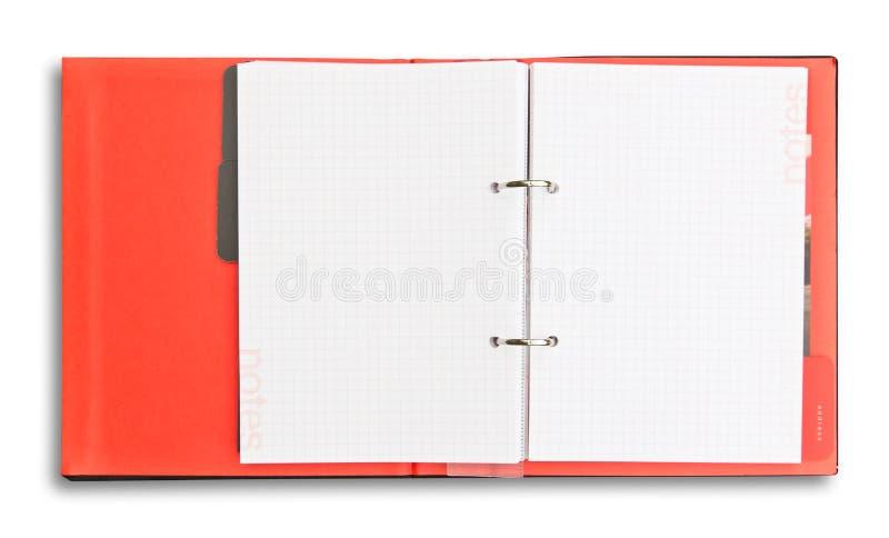Isolerad röd anteckningsbok royaltyfria foton