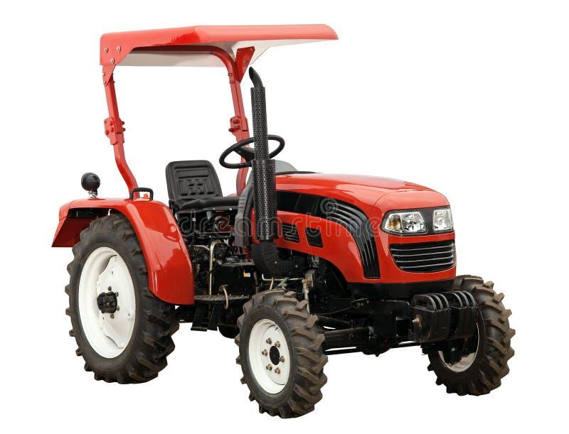 isolerad röd traktorwhite för ny over bana royaltyfria bilder